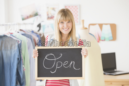 portrait of female business owner holding
