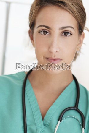 young female doctor in hospital corridor