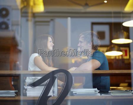portrait of couple talking in coffee