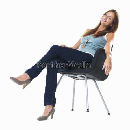 studio shot of young woman sitting