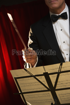 midsection of orchestra conductor