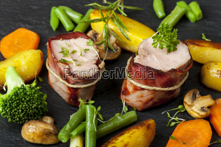 grilled pork with ham in a