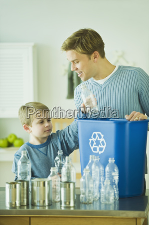 father and son recycling