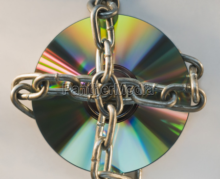 compact disc locked with metal chain