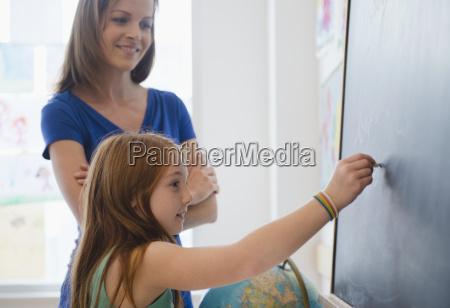school girl 8 9 writing on