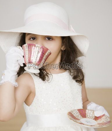 hispanic girl dressed up at tea