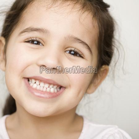 close up of hispanic girl smiling