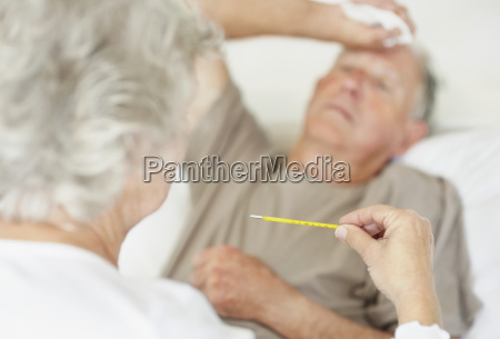 senior woman caring for man with