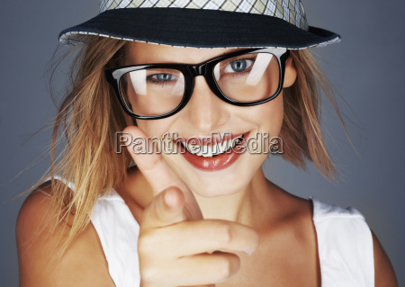 blond woman wearing sunglasses and sunhat