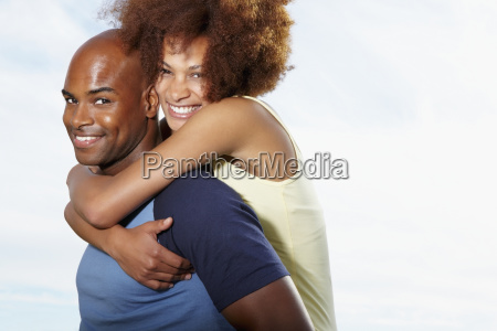 man giving woman a piggy back