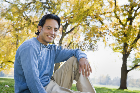 man sitting in grass