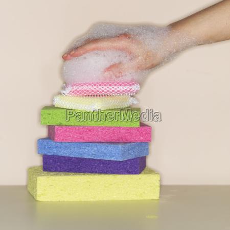 female hand covered in foam on