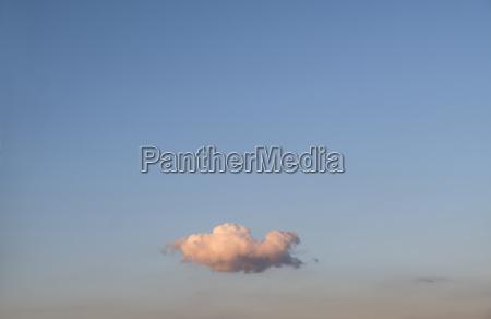 single cloud on blue sky at