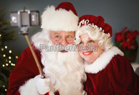 santa and mrs santa taking selfie