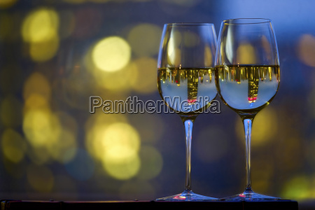 two wineglasses with white wine