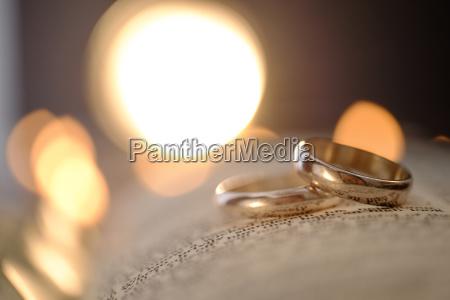 wedding rings in open bible