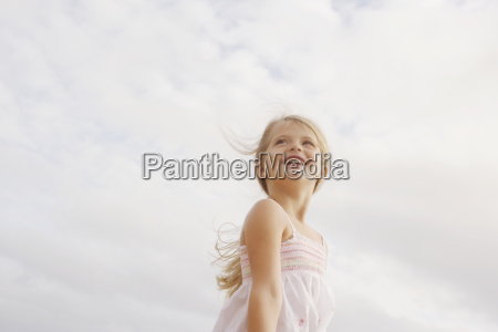 low angle view of girl looking