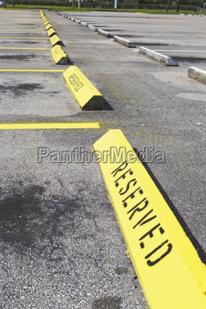 row of reserved parking spaces