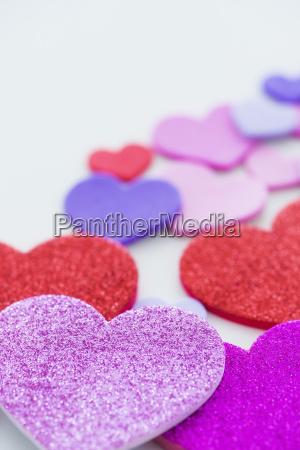 studio shot of foam hearts on