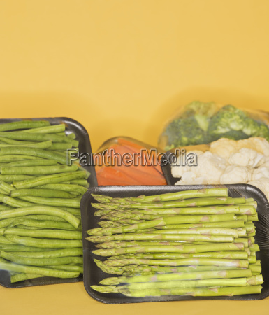 studio shot of vegetables wrapped on