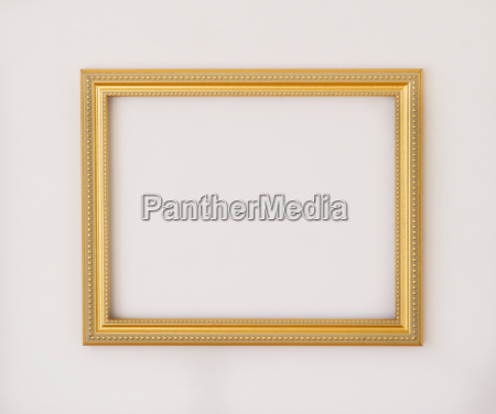 studio shot of golden picture frame