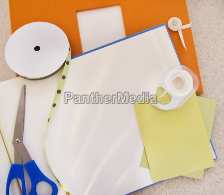 unfinished scrapbook and materials