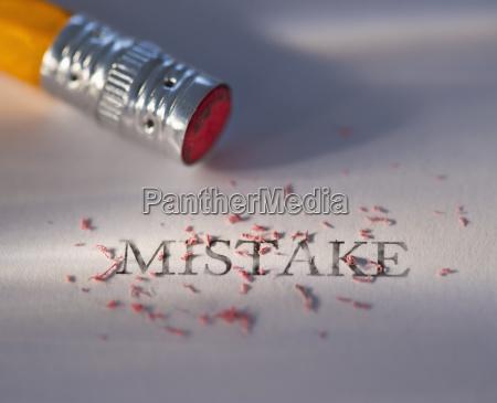 studio shot of pencil erasing the