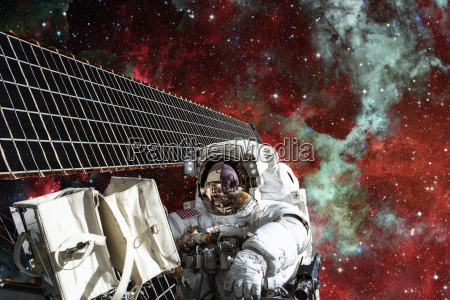 cosmonaut works outside the international space