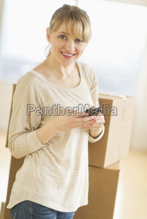 woman using smart phone during relocation