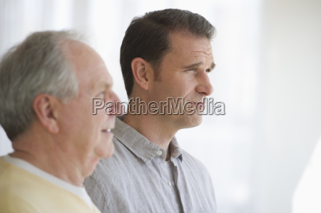 senior father with adult son