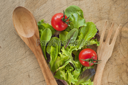 salad leaves and wooden spoon and