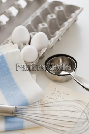 studio shot of eggs egg whisk