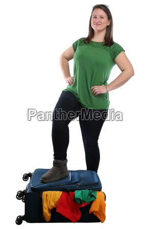 young woman packing suitcase travel traveling
