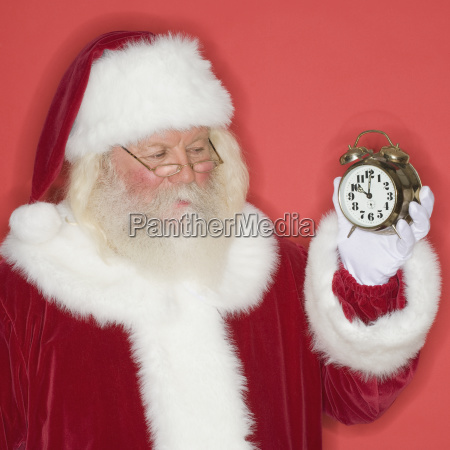 santa claus holding alarm clock