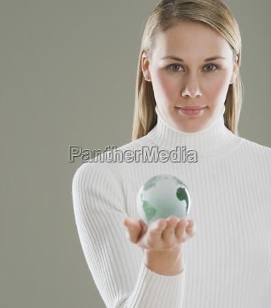 woman holding glass globe