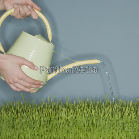 woman water grass with watering can