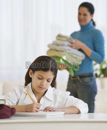 hispanic girl doing homework