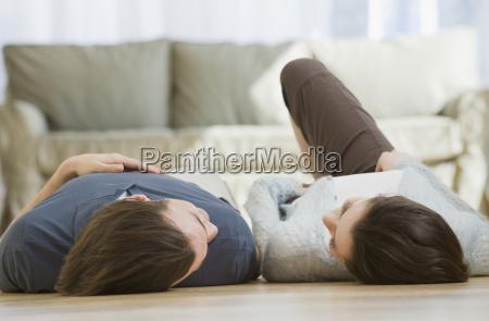 couple, laying, on, floor - 24065864