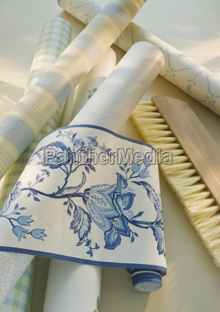 assorted wallpaper and brush