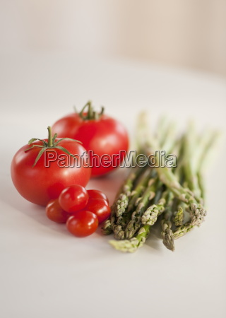 tomatoes and bunch of asparagus