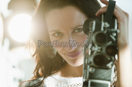 portrait of female filmmaker using film