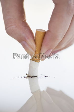 hand putting out cigarette