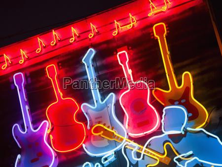 illuminated guitars on beale street in
