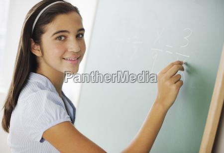portrait of girl 12 13 writing