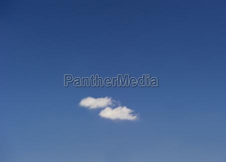 single cloud in blue sky
