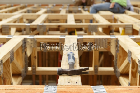 hammer on the roof at construction