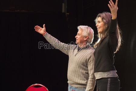 hispanic man and woman with arms