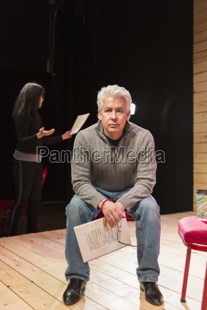 hispanic man holding script on theater