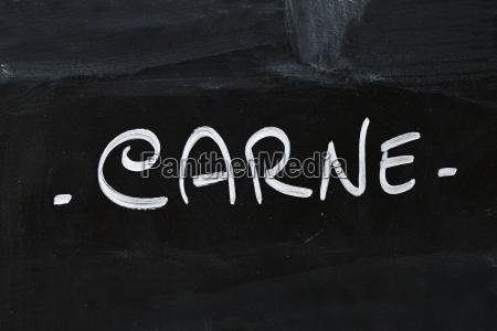 white chalk carne word over black