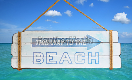 way to beach sign over blue